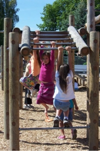 Little girls playing on monkey bars
